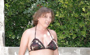 Fatty granny takes off bikini outdoor to expose her ass on high heels