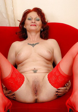 Fuckable redhead granny in stockings stripping off her red lingerie