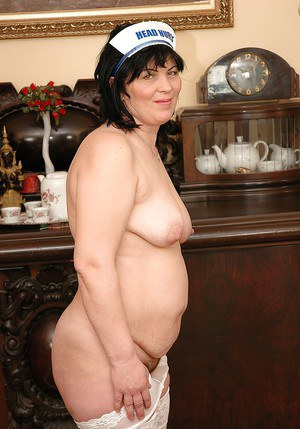 Fatty granny taking off her lingerie and posing in white stockings