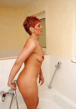 Stunning short haired granny with ample ass stripping and taking a shower