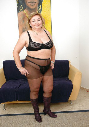 Fatty granny in pantyhose with big tits spreads her legs to show pussy