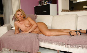 Stunning blonde granny taking off her lingerie and spreading her legs