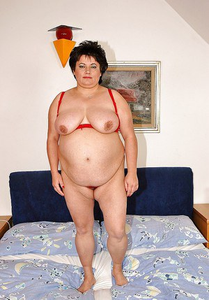 Fatty granny taking off her lingerie and toying her wet twat