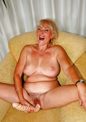 Big titted granny shows her cunt and plays with a massive toy