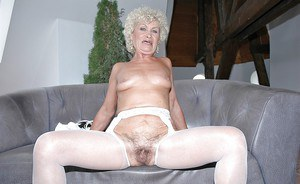 Filthy granny in stockings stripping and toying her hairy cunt