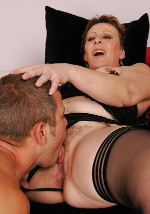 Chubby mature babe in stockings gets slammed hardcore by a younger guy