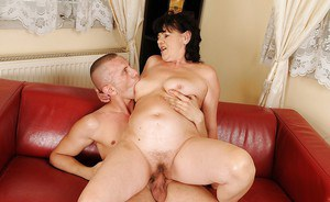 Horny mature brunette Helena May gets shagged hardcore by a younger guy