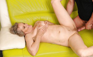 Big busted granny gives a blowjob and gets her hairy cunt screwed
