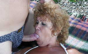 Big busted granny in bikini gives a blowjob and gets shagged outdoor