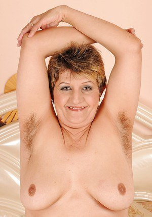 Short haired mature lady showcasing her hairy armpits and shaggy twat