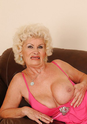 Big busted granny stripping off her pink dress and white panties