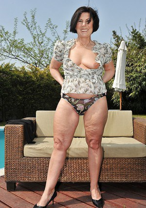 Filthy mature brunette showcasing her fuckable body outdoor