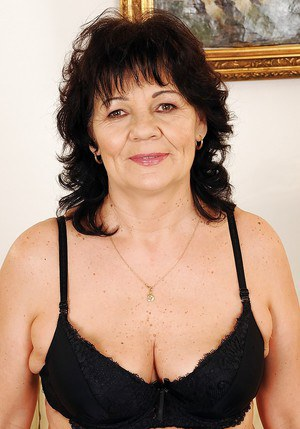 Busty granny in lingerie Helena May stripping and spreading her legs