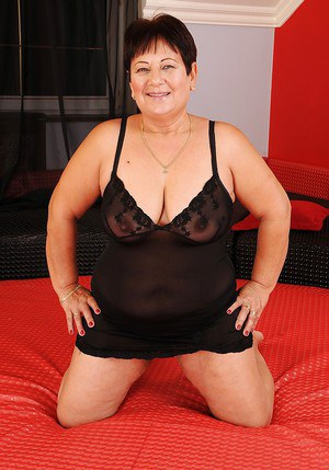 Fatty mature brunette with big tits stripping and spreading her legs