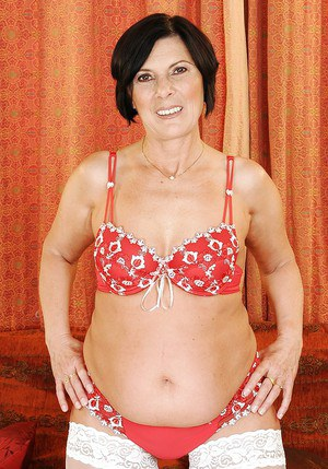 Fatty granny in white stockings slipping off her lacy lingerie