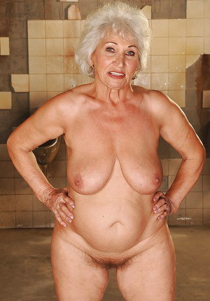 Chubby granny with big flabby boobs slipping off her fancy dress