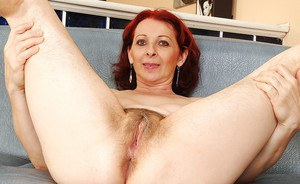 Redhead mature lady stripping and exposing her hairy armpits and bushy cunt