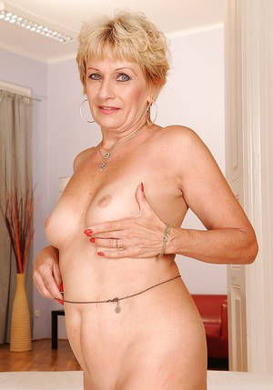 Blonde granny with tiny tits stripping and exposing her fuckable body