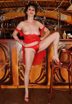 Busty granny on high heels slipping off her red dress and panties