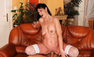 Stunning mature brunette in white stockings sucks and fucks a young cock