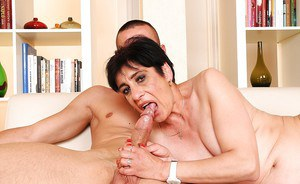 Short haired granny gives a blowjob and gets her bushy twat drilled