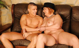 Redhead mature plumper with flabby jugs gets banged by a younger guy