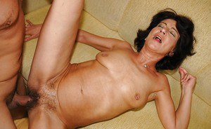 Mature brunette with small titties gets her unshaven twat slammed