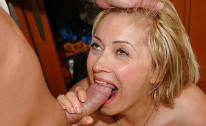 Slutty mature blonde gives a blowjob and gets fucked in the kitchen