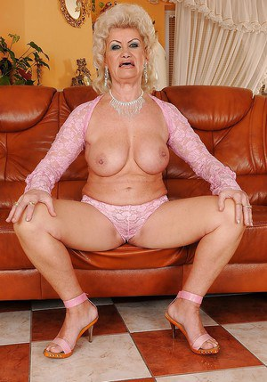 Lusty granny showcasing her big jugs and fuzzy ass covered with panties