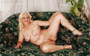 Naughty granny on high heels slipping off her dress and panties