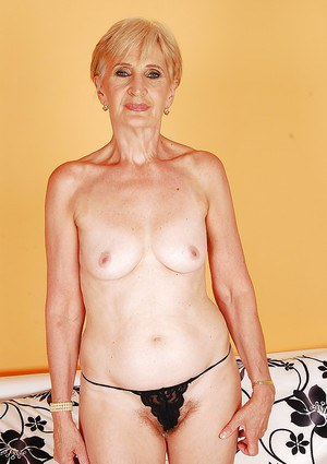 Short haired granny taking off her lingerie and showing off her hairy vag
