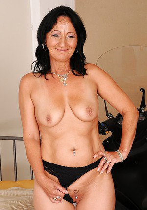 Brunette granny with big flabby tits taking off her dress and panties