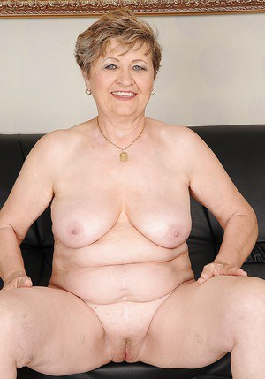 Busty granny on high heels stripping and spreading her legs