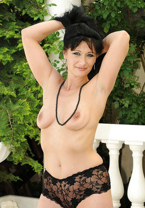 Fuckable mature brunette stripping off her clothes outdoor