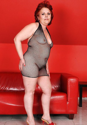 Fatty granny in a fishnet dress spreading her hairy cunt