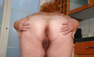 Fatty granny on high heels spreading her ass to show her tight holes