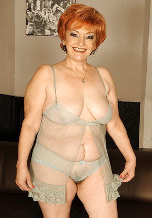 Busty granny on high heels shows her fatty body and her hairy cunt