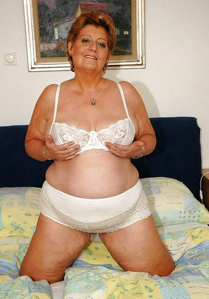Fatty granny plays with her boobs and shows her hairy cunt