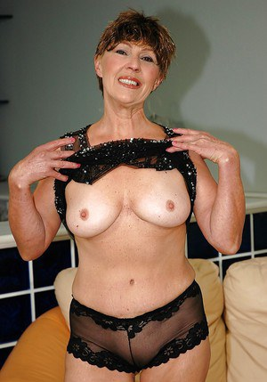 Big titted filthy granny shows her shaved cunt and her butthole