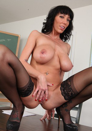 Busty teacher in glasses Alia Janine stripping off her clothes in the class