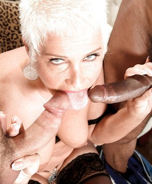 Horny mature blonde Trinity Powers gets blowbanged and fucked by two guys