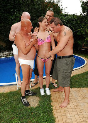 Slutty european babe gets pissed on and bukakked by four guys outdoor