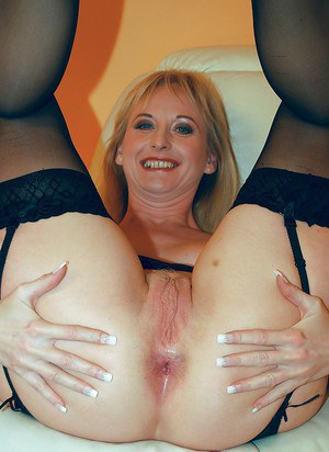Busty European MILF babe in stockings getting naked and horny