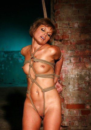 MILF babe with tiny tits Szilvia Lauren gets ready for BDSM