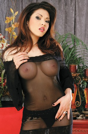 Latina pornstar babe bends over in stockings to show pussy