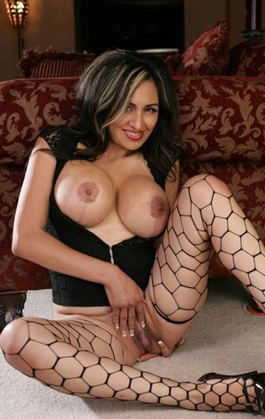 Latina with big tits Chica Caramelo poses in stockings spreading pussy