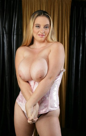 MILF babe with big tits April McKenzie spreading legs and toys pussy