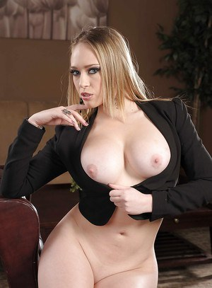 Stunning babe  Kagney Linn Karter with big tits gets horny in office