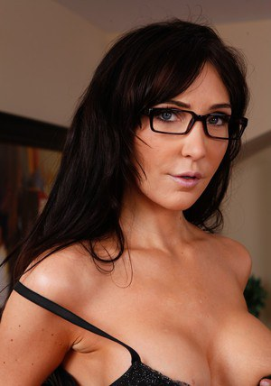 MILF babe Diana Prince in sexy glasses getting naked in office