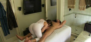 Hot Rachel Roxxx gives a titjob and gets fucked on the massage table